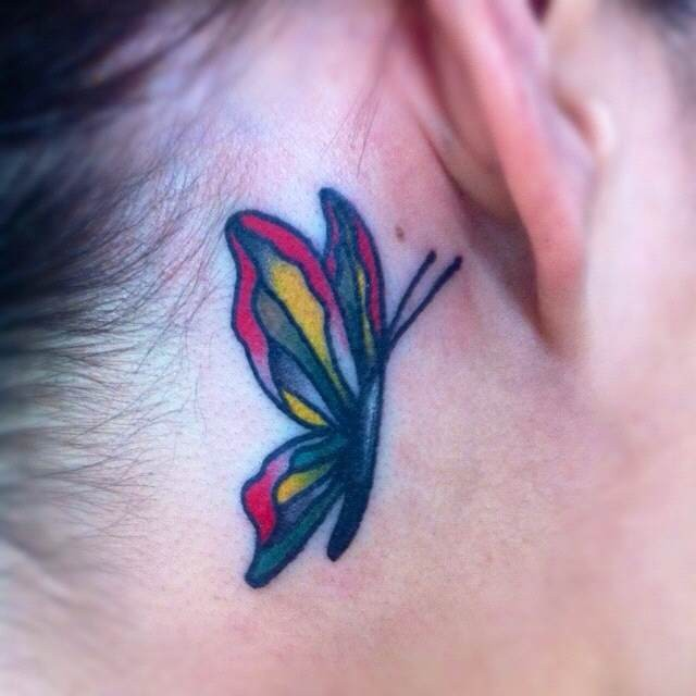 Pretty traditional butterfly tattoo behind ear