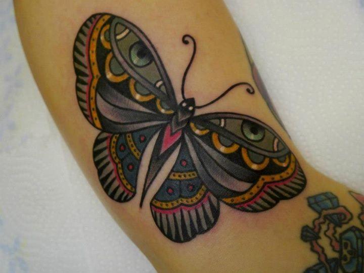 Pretty traditional butterfly tattoo design idea
