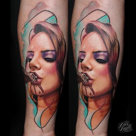Pretty young woman drinking from bottle colored portrait tattoo in new school style on arm