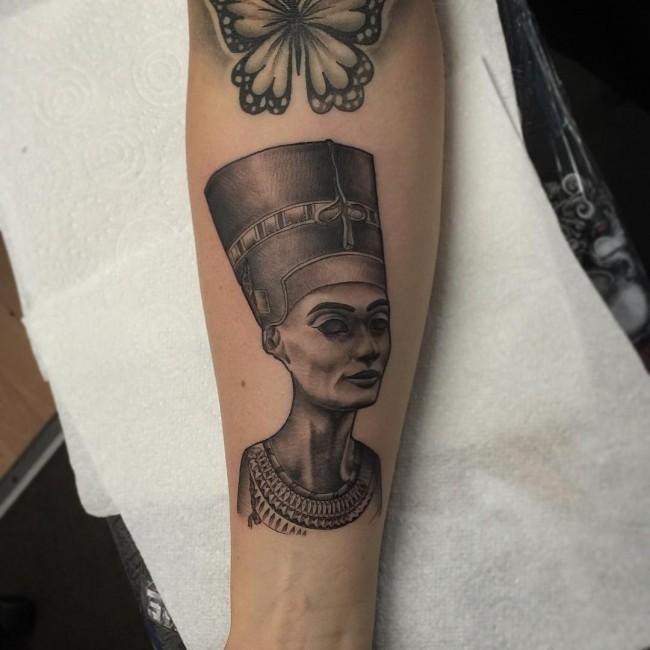 Princess Nefertiti pale ink forearm tattoo in Egyptian style
