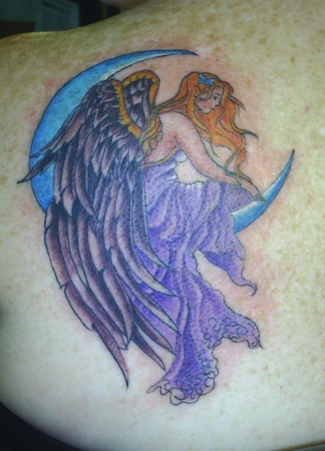 Purple angel sitting on moon tattoo on shoulder blade