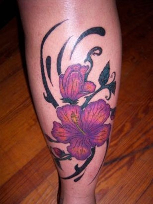 Purple hibiscus flowers tattoo on leg