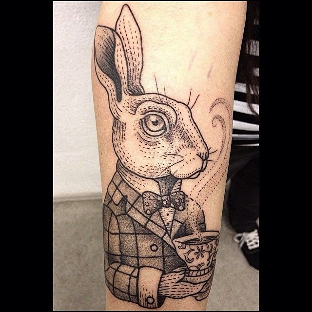 Rabbit from Alice in Wonderland with steaming tea cup forearm tattoo with small details