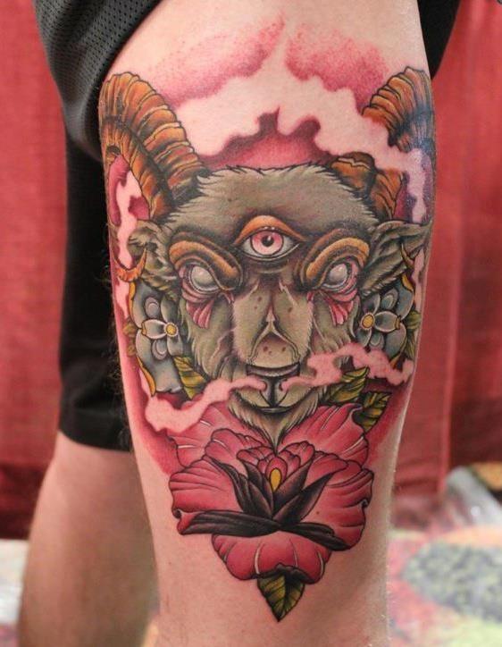 Tattoo von Ramm mit rosa Blumen