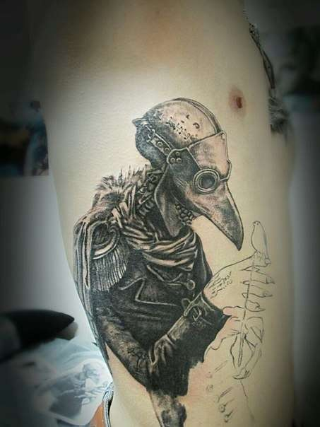 Real life like unfinished side tattoo of plague doctor with rose