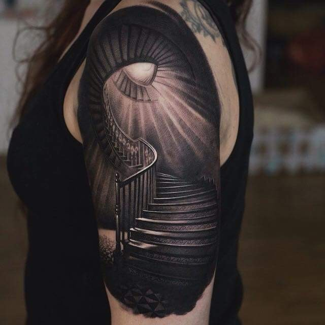 Real photo colored mystical forearm tattoo of stairs