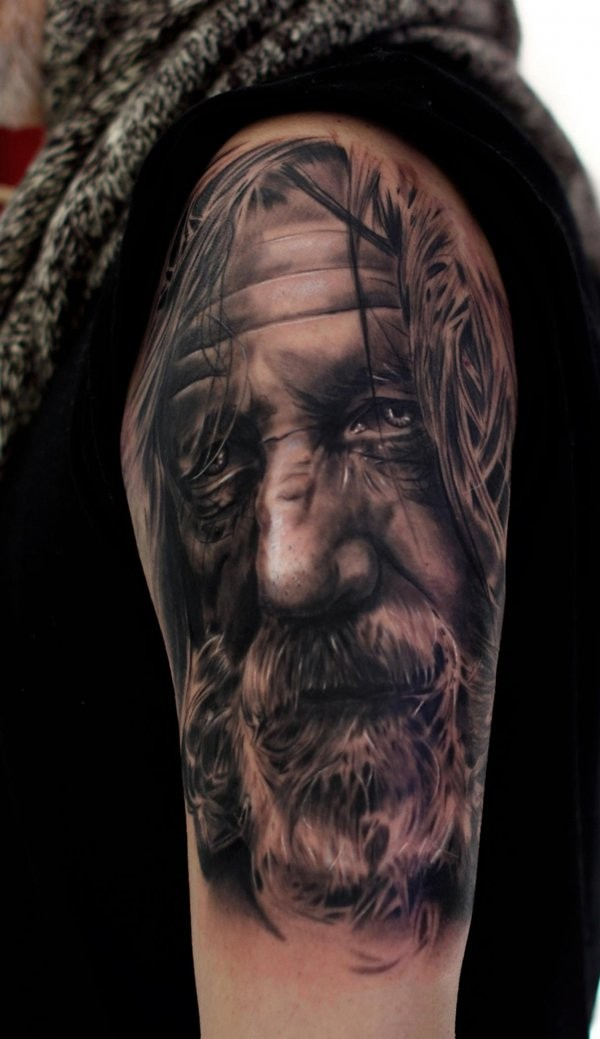 Real photo like amazing detailed black and white old wizard tattoo on shoulder