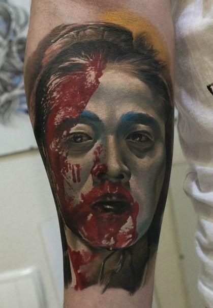 Real photo like big colored forearm tattoo of bloody geisha portrait