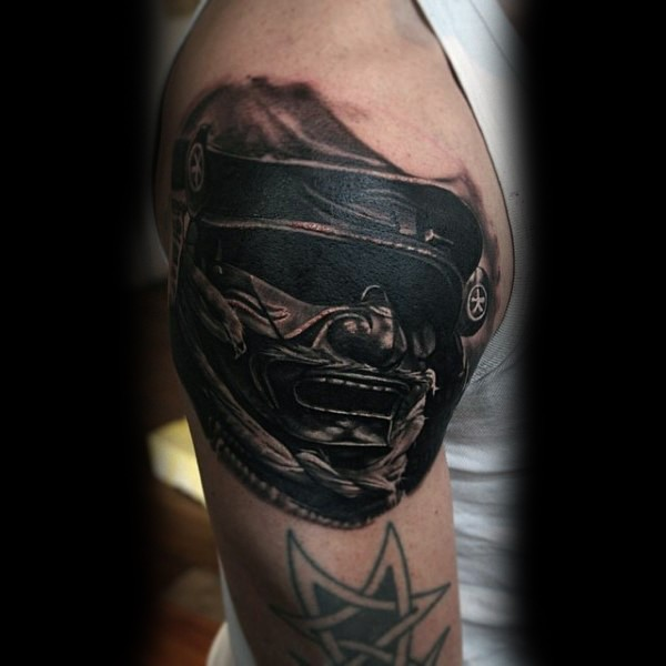 Real photo like black and white Asian warrior mask tattoo on shoulder