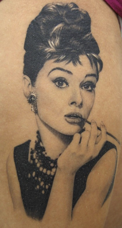Real photo like black and white beautiful Audrey Hepburn portrait tattoo on thigh