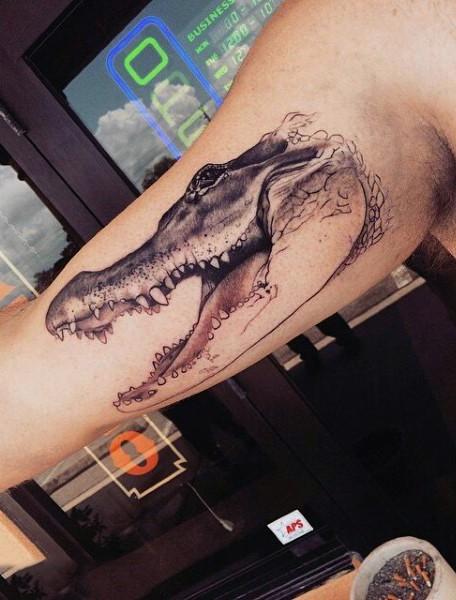 Real photo like black and white little alligator head tattoo on arm