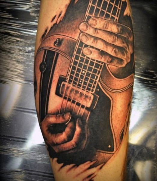 Real photo like black and white musician playing the guitar tattoo on leg