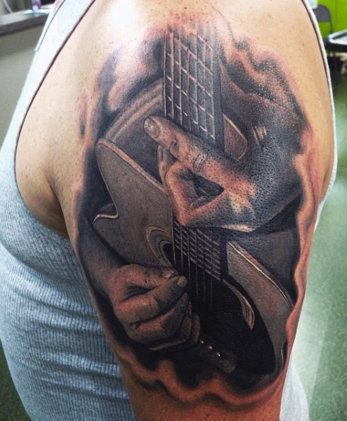 Real photo like black and white musician with guitar tattoo on shoulder