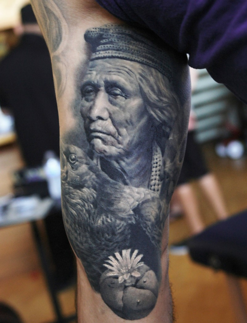 Real photo like black and white old Indian tattoo on arm stylized with detailed eagle and flower