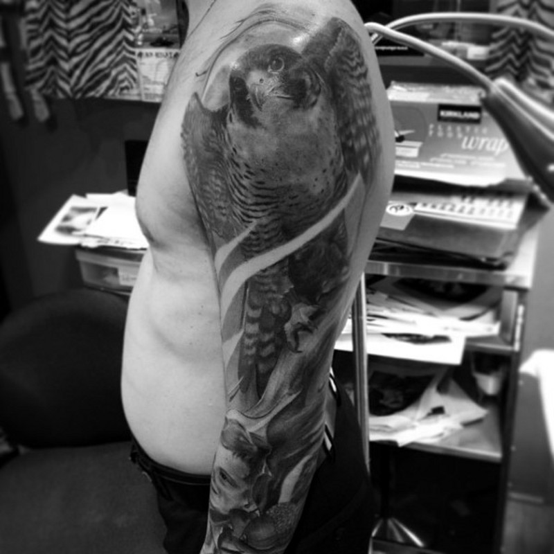 Real photo like black and white shoulder tattoo of spectacular eagle