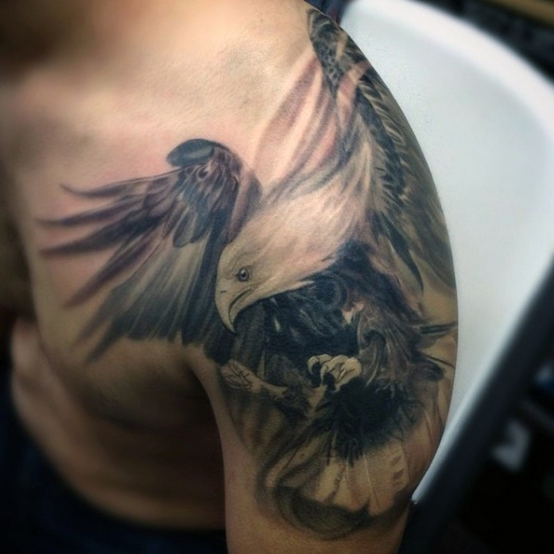 Real photo like black and white shoulder tattoo of flying eagle