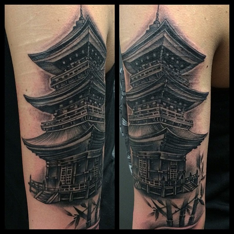 Real photo like black and white shoulder tattoo of antic Asian temple and bamboo