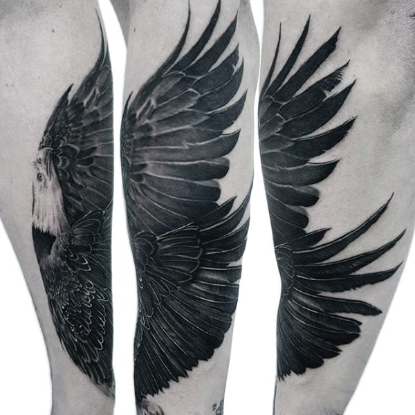 Real photo like black and white very detailed eagle tattoo on arm