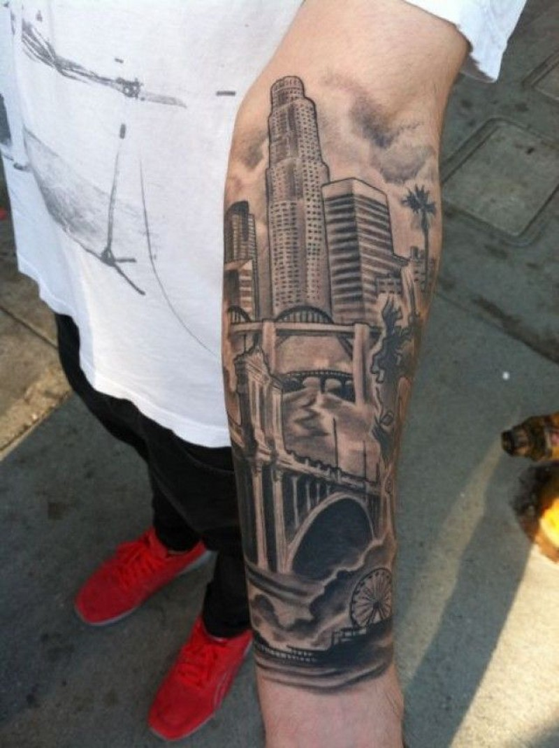 Real photo like black ink forearm tattoo of city sights
