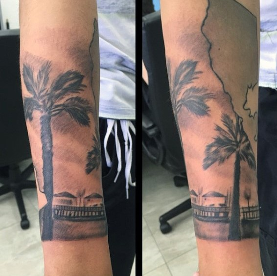 Real photo like black ink ocean shore with house and palm trees tattoo on sleeve