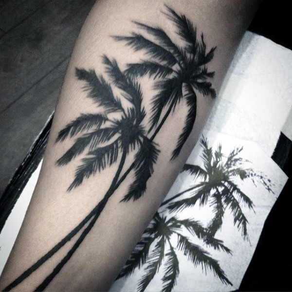 Real photo like black ink palm trees tattoo on arm