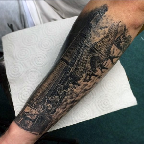 Real photo like black ink train with people tattoo on arm