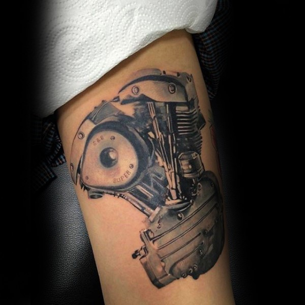 Real photo like colored arm tattoo of small bice engine