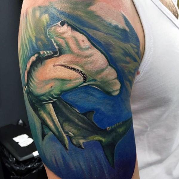 Real photo like colored shoulder tattoo of hammerhead shark
