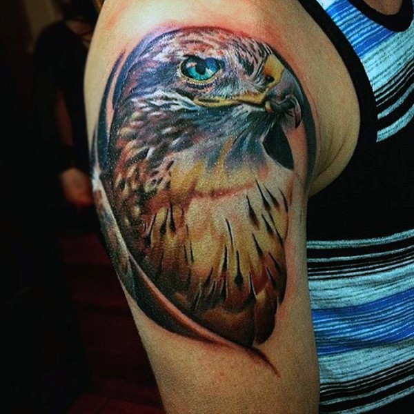 Real photo like colorful detailed eagle tattoo on upper arm