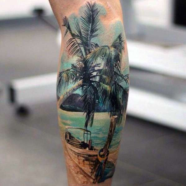 Real photo like colorful old boat with palm tree and ocean tattoo on leg
