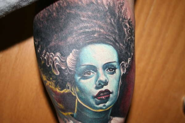 Real photo like creepy horror woman tattoo on leg