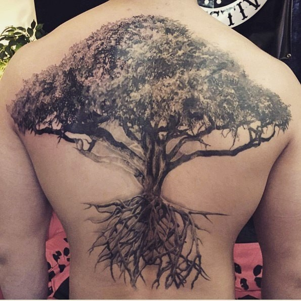 Real photo like magnificent detailed black and white whole back tattoo of tree