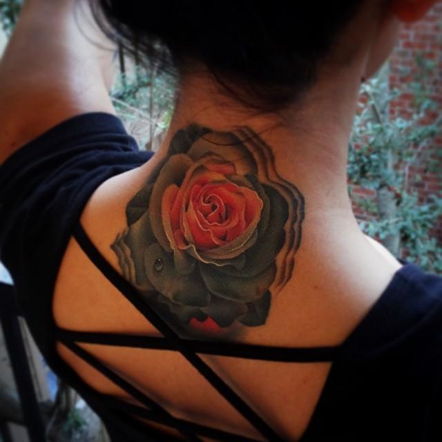 Real photo like multicolored big rose tattoo on neck