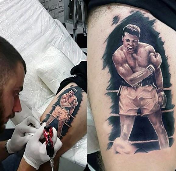 Real photo like multicolored Muhammad Ali tattoo on thigh