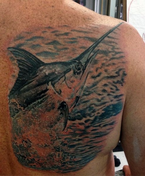Real photo like very detailed and cored big ocean fish tattoo on chest