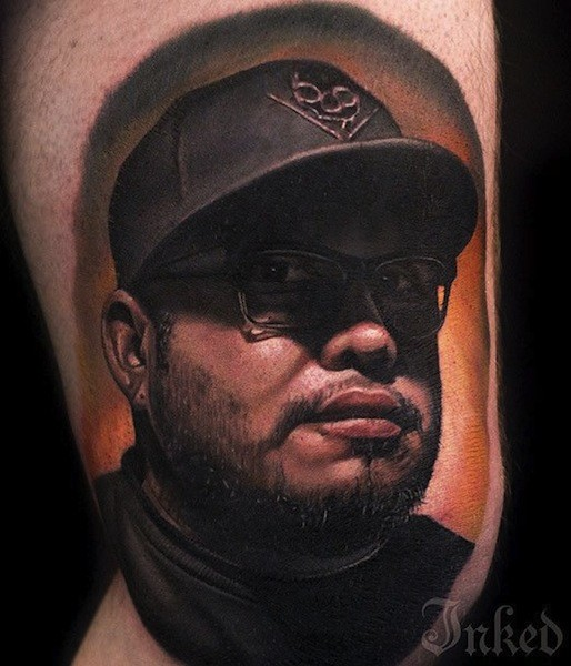 Real photo like very detailed arm tattoo of famous star portrait