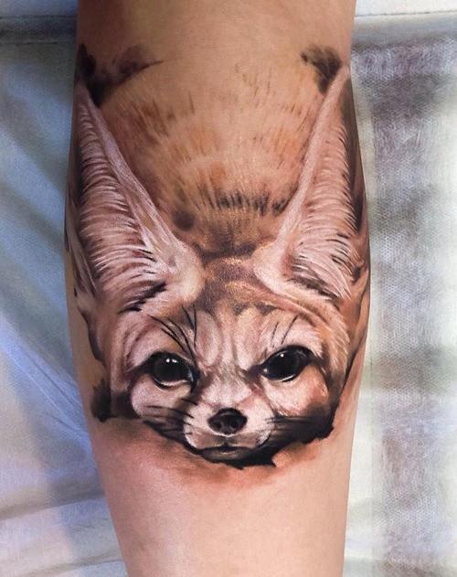 Real photo like very detailed leg tattoo of baby fox head