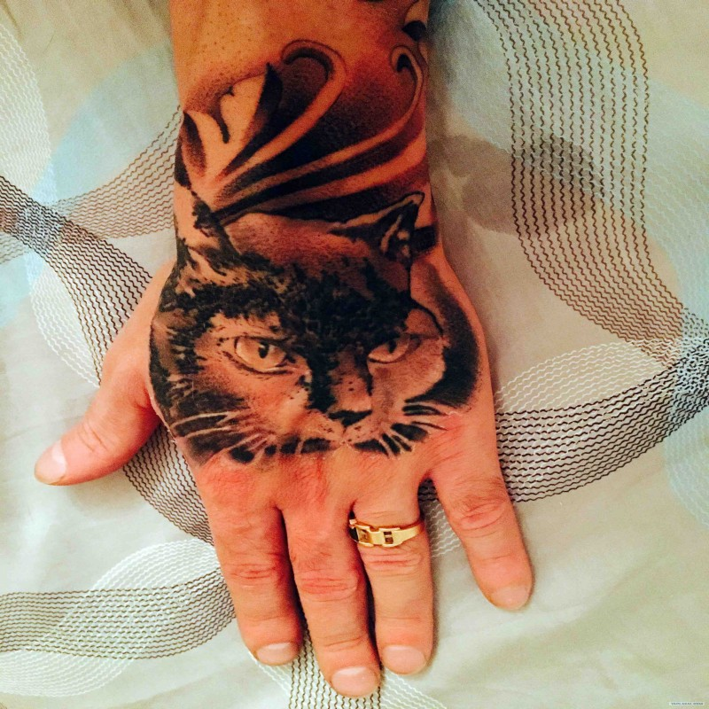 Real photo style black and white hand tattoo of mysterious cat