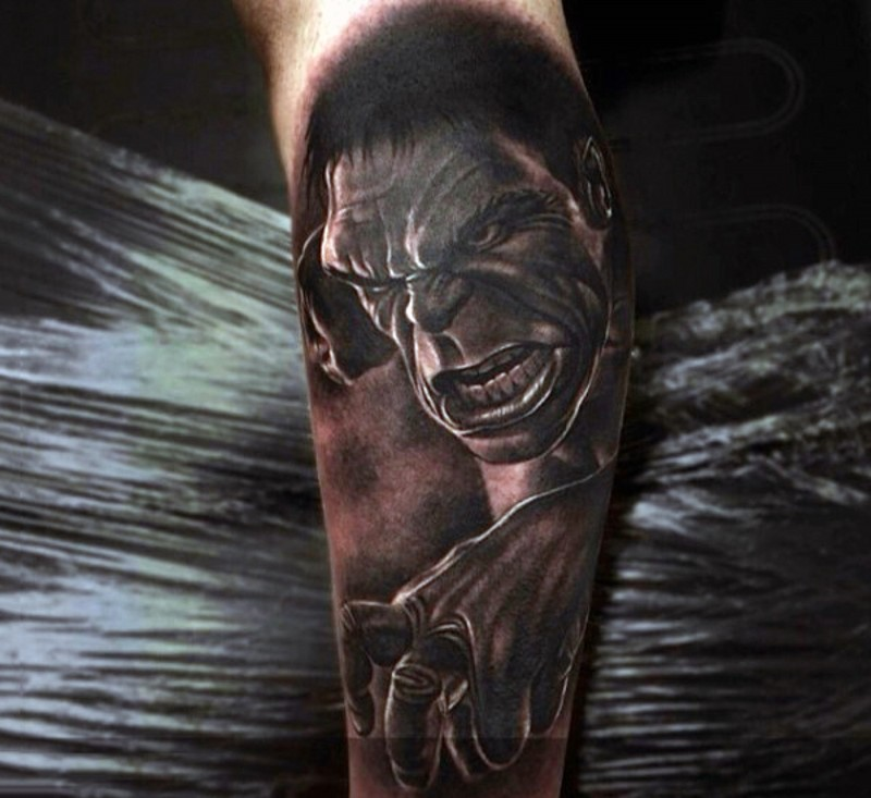 Real photo style black and white leg tattoo of angry fighting Hulk