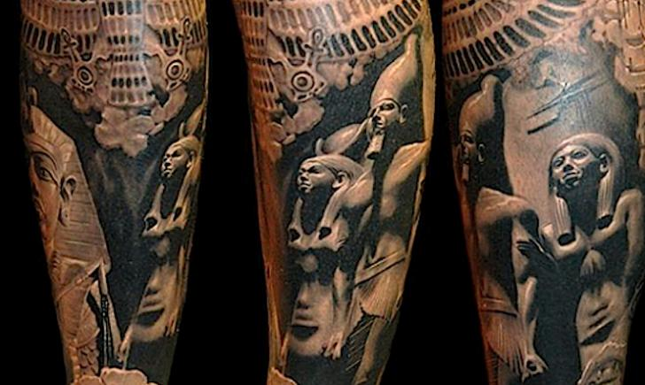 Real photo style black and white various Egypt statues tattoo on leg