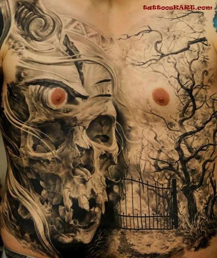 Real photo style human skull tattoo on chest combined with dark forest