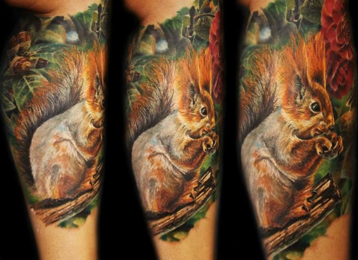 Real photo style painted and colored cute squirrel tattoo on leg