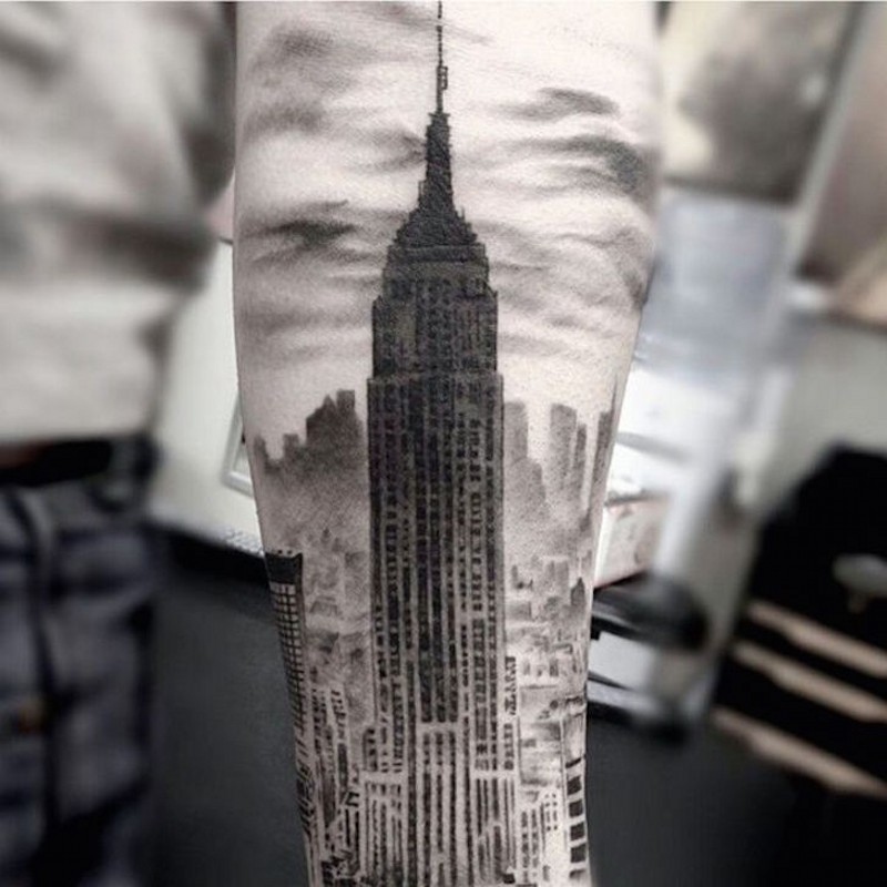 Real vintage photo like black and white forearm tattoo of Empire State Building