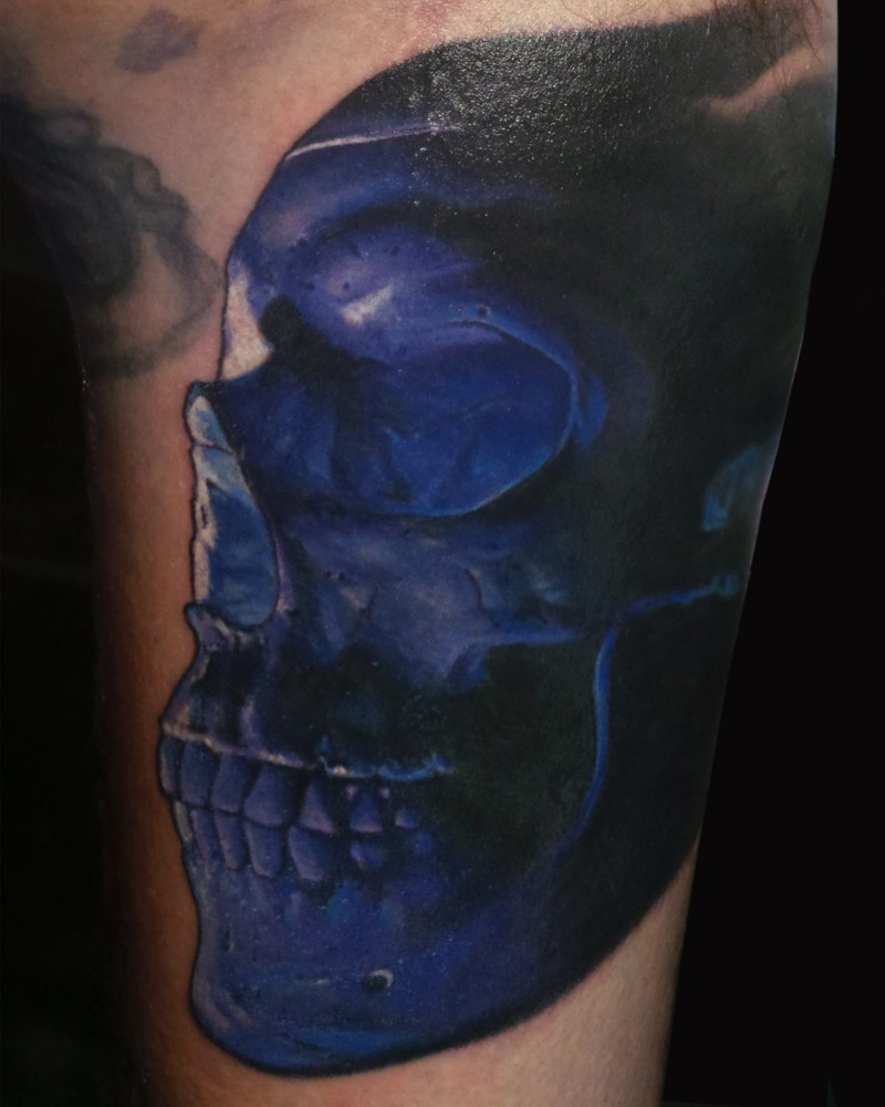 Realism style awesome colored human skull tattoo