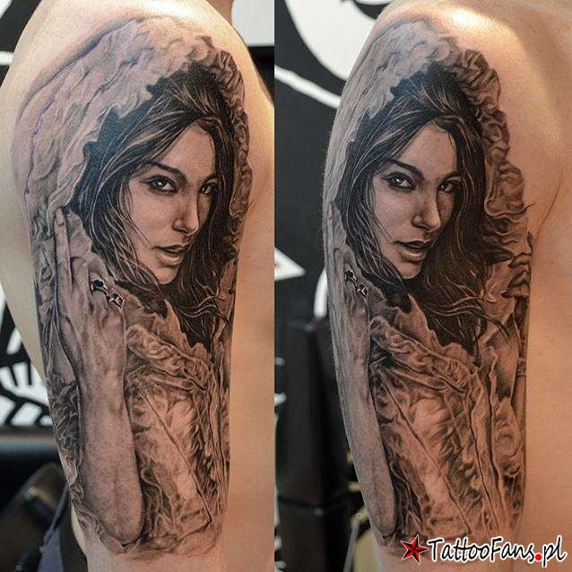 Realism style beautiful looking black ink shoulder tattoo of beautiful woman