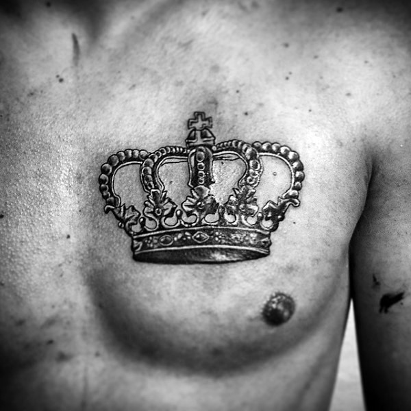 Realism style beautiful looking crown tattoo on chest for Crown chest tattoo