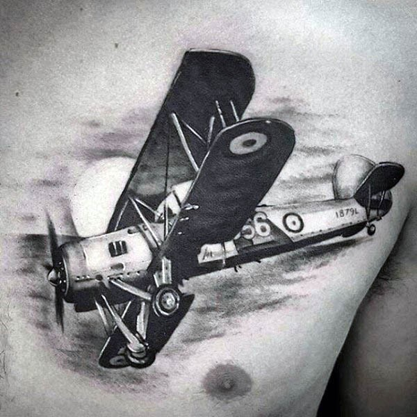 Realism style black and white chest tattoo of antic fighter plane