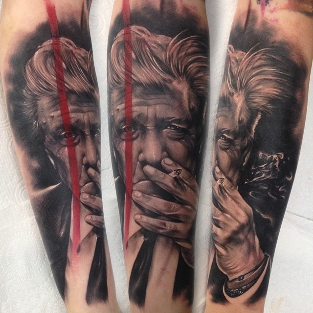 Realism style black and white forearm tattoo of smoking old man portrait