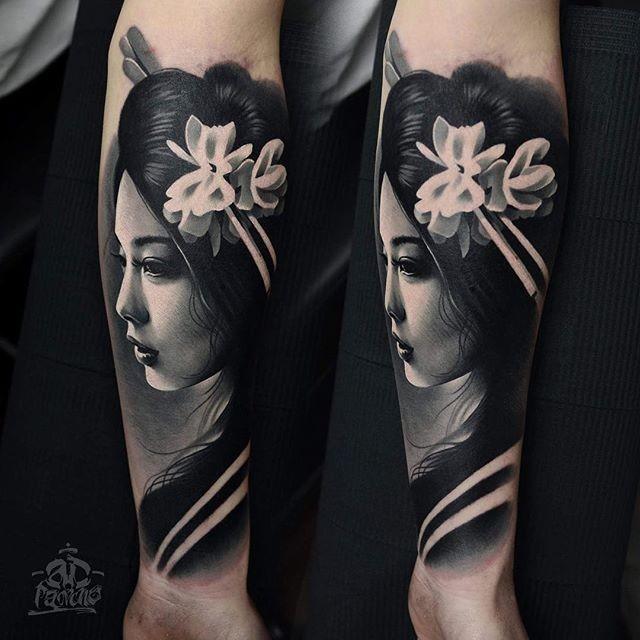 Realism style black and white forearm tattoo of geisha portrait