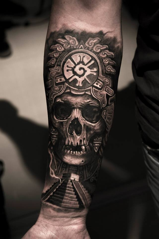 Realism style black and white forearm tattoo of human skull with helmet